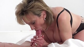 Busty aged slut is fucked and cummed on